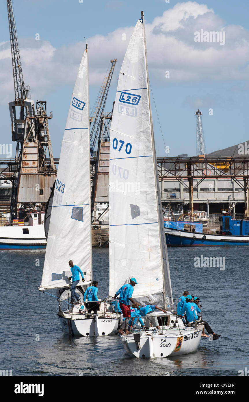 Cape Town harbour South Africa. December 2017. Teenagers receiving some sailing experience on the harbour - Stock Image