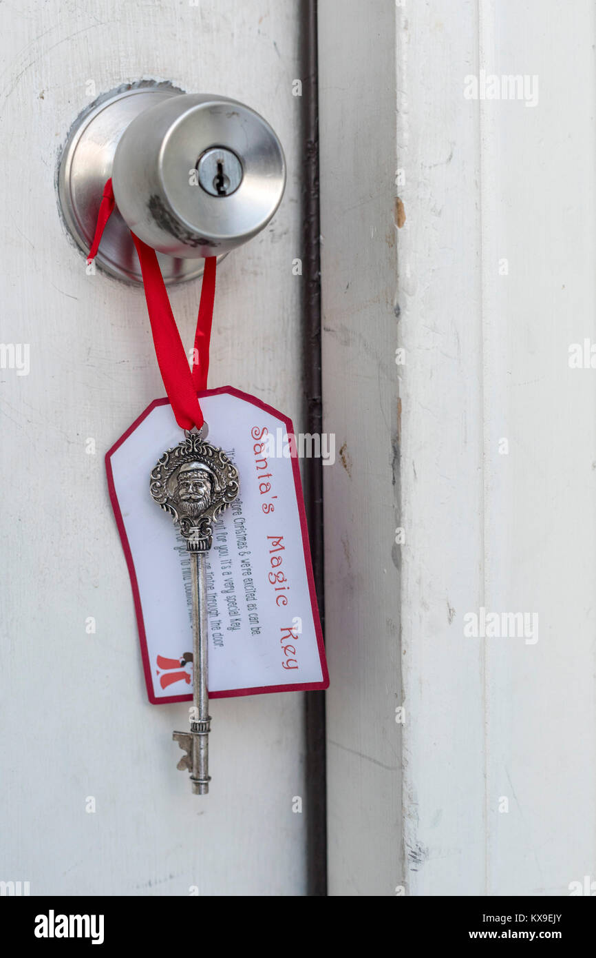Wheat Ridge, Colorado - Santa's Magic Key, hanging on Christmas Eve on the front door of a home with a young - Stock Image