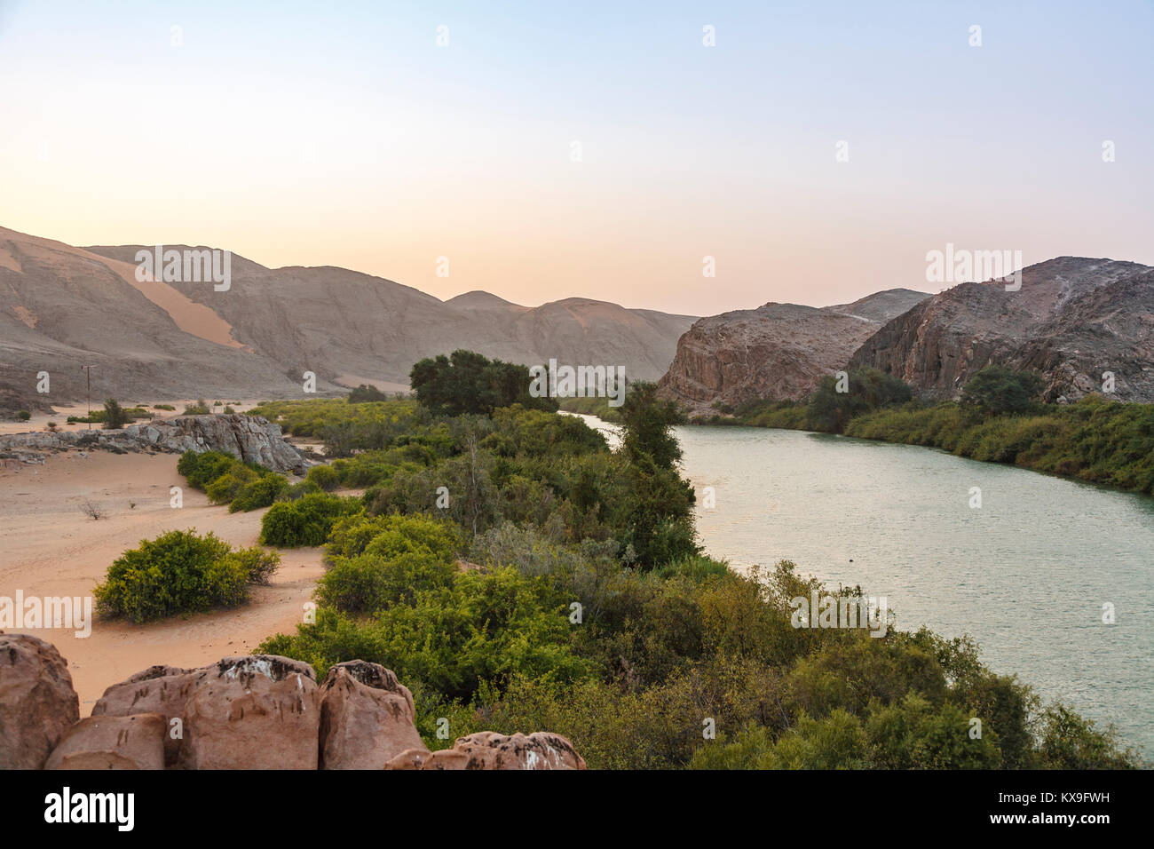 Kunene River (Cunene River), the border between Angola and Namibia, south-west Africa (view towards Angola) - Stock Image