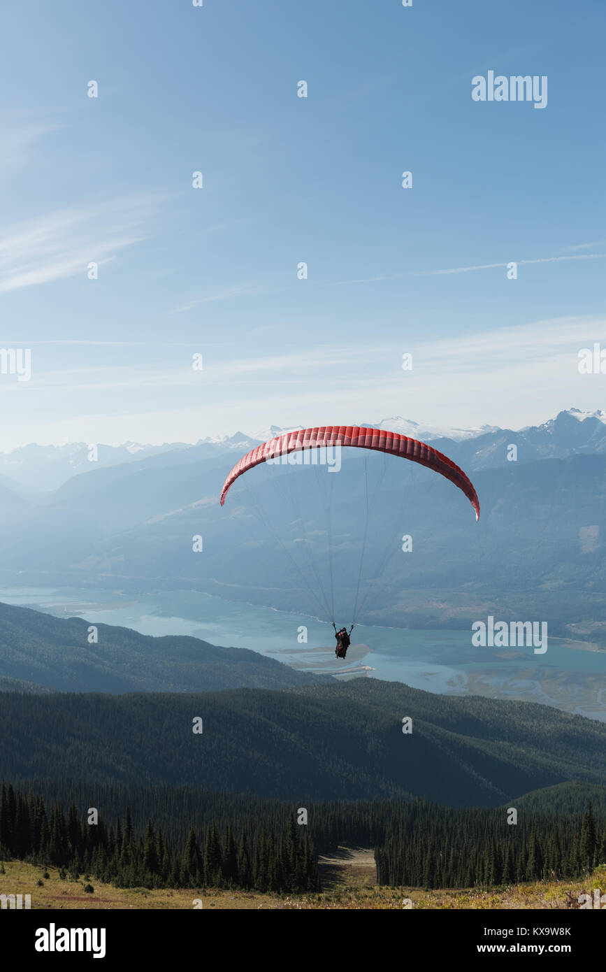 Paraglider flying over beautiful mountain - Stock Image
