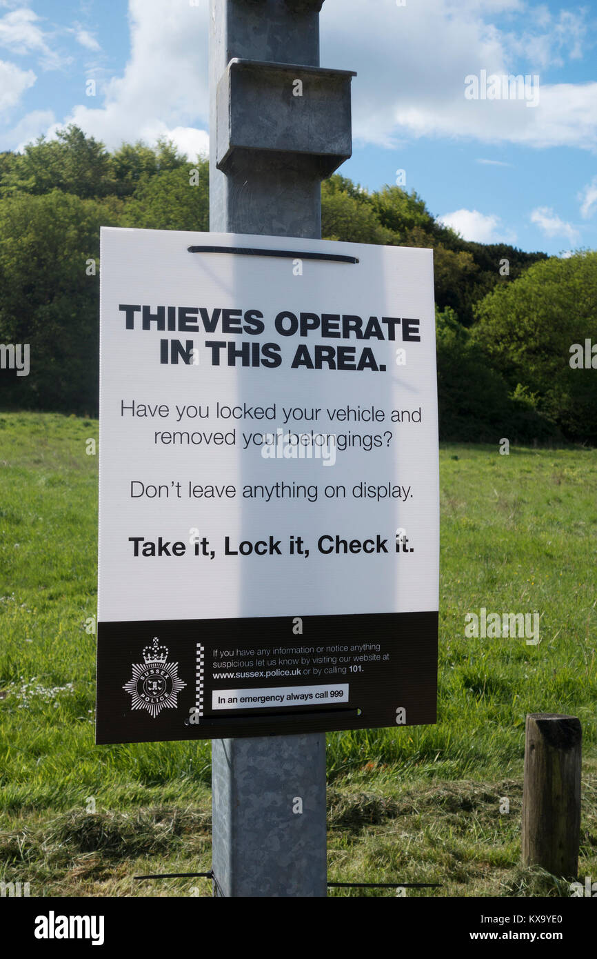 Thieves operate in this area sign at Stoughton car park, West Sussex - Stock Image