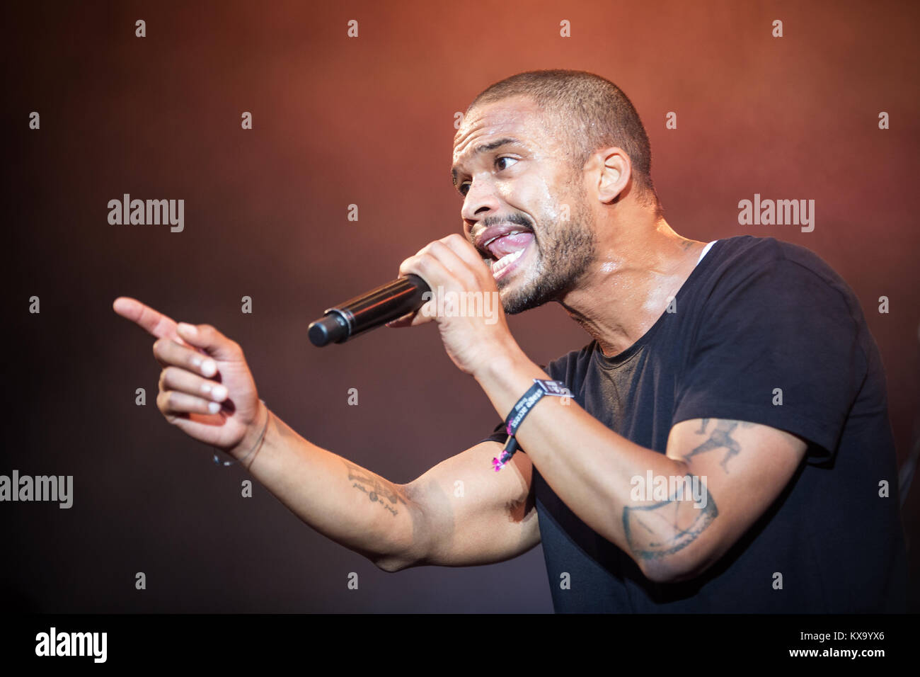 The popular Danish musician, songwriter and rapper Shaka Loveless performs a live concert at the Danish music festival - Stock Image
