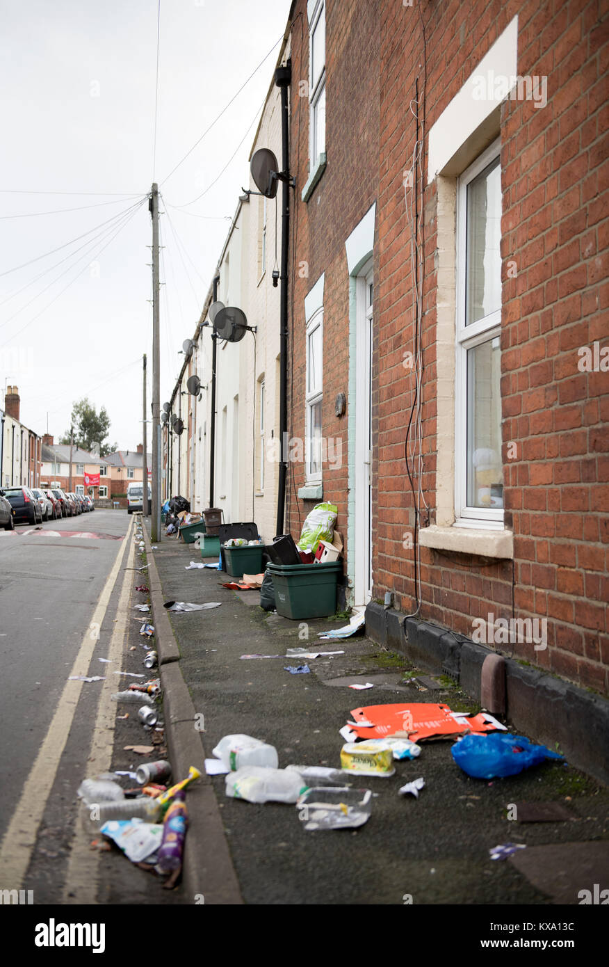 Rubbish blown around a Gloucester street on recycling day UK - Stock Image