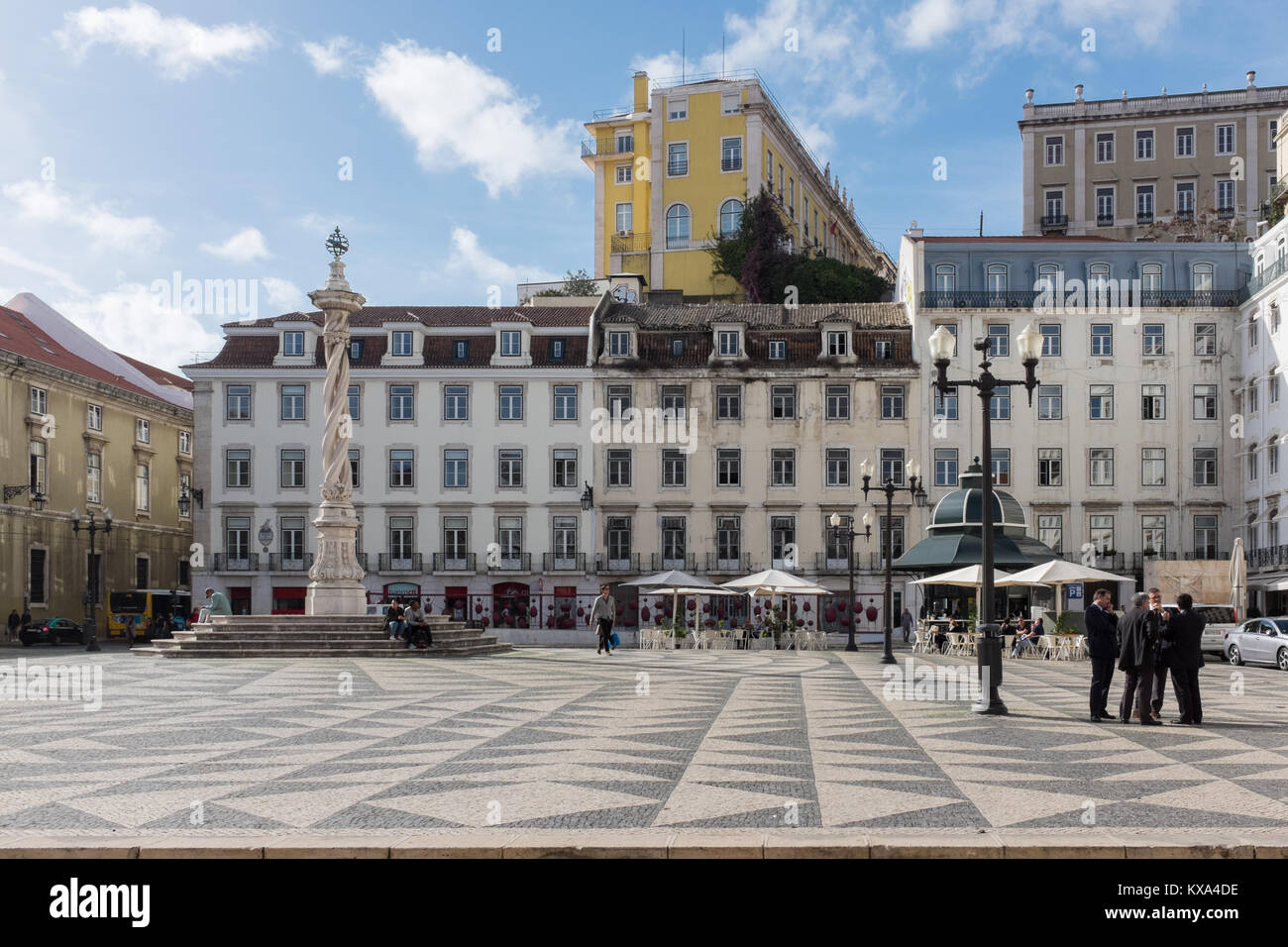 Praca do Municipio or Municipal Square in Lisbon with decorative tiles and tall statue - Stock Image