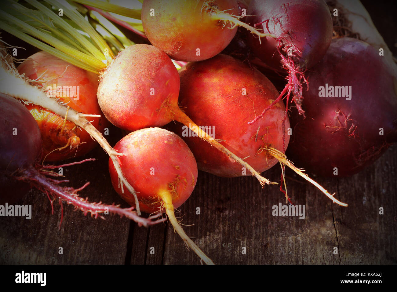 Fresh farm colorful beetroot on a wooden background. Detox and health. Selective focus. Red, golden, white beet - Stock Image