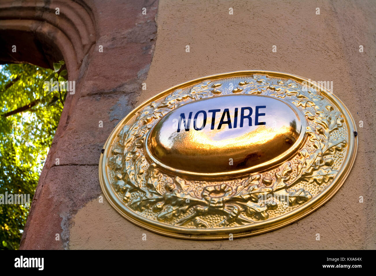 'Notaire' Notary Notarise Notarize legal office in France brass plaque sign at sunset imposing entrance - Stock Image