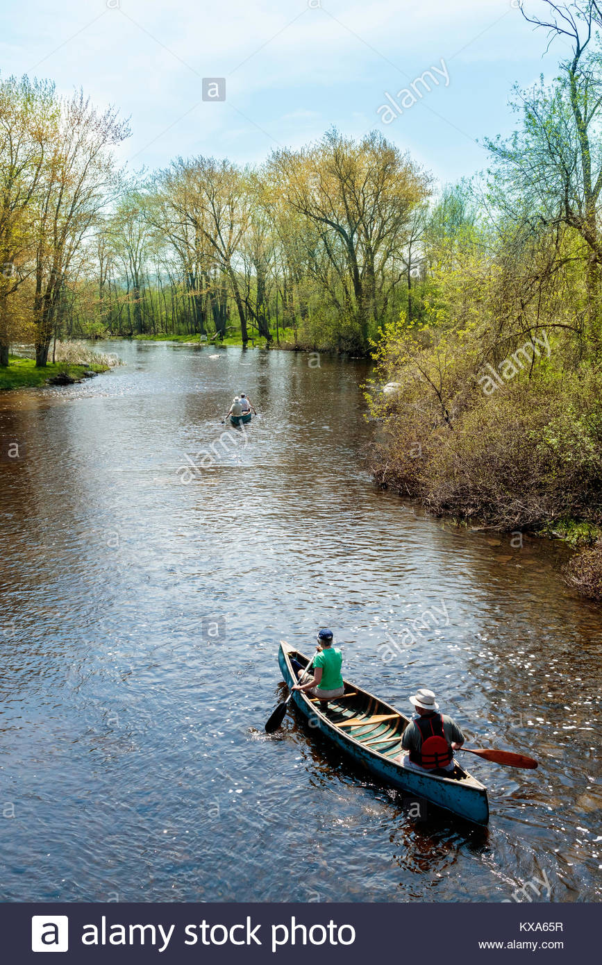 Paddling a canoe down the Indian river in spring in Peterborough County Ontario Canada. canoe water river paddling - Stock Image