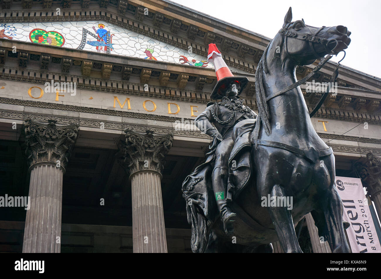 Famous equestrian statue of Duke of Wellington  with a road cone on his head, and a Santa hat during the festive - Stock Image