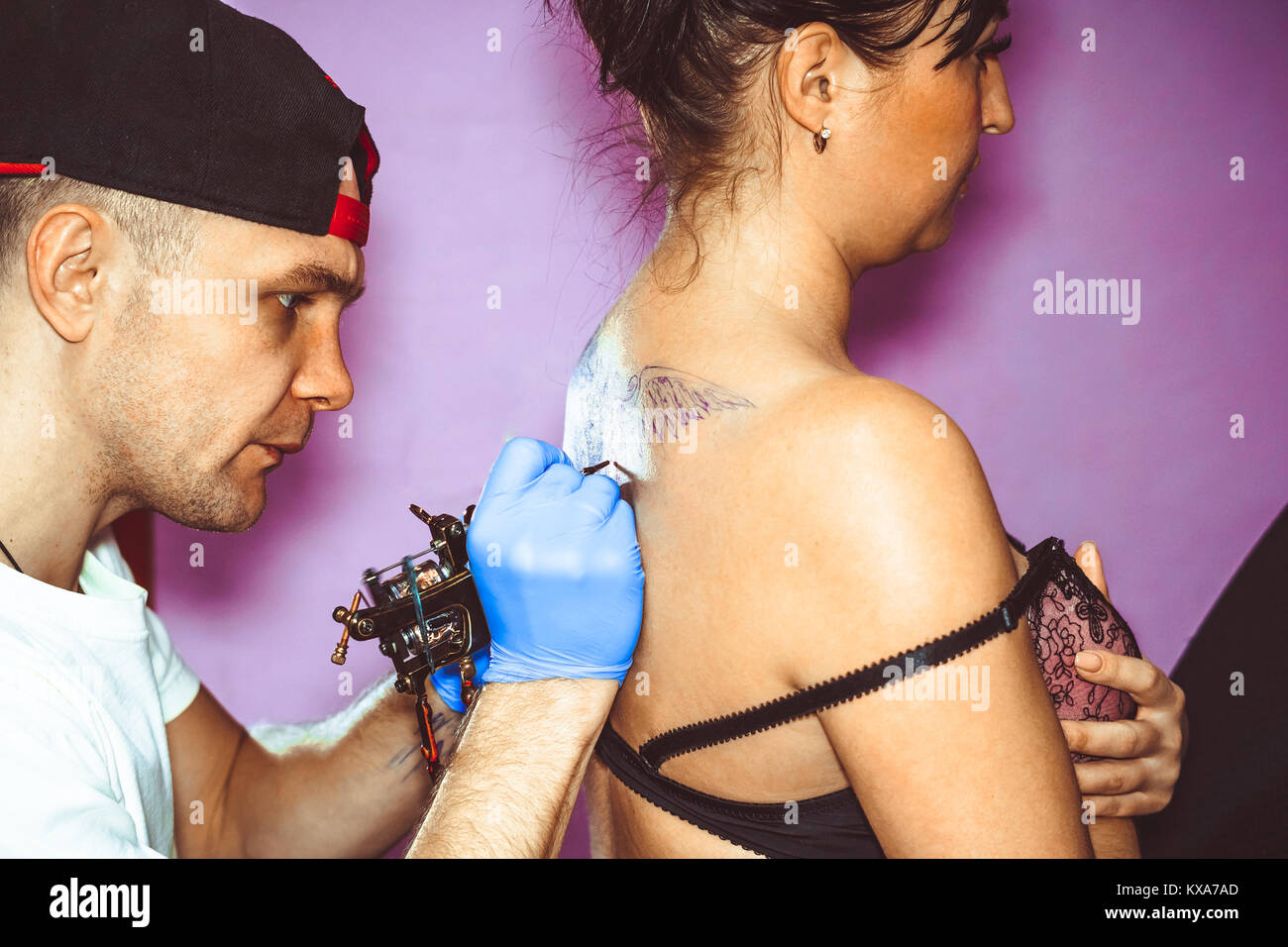 master tattoo woman on her back - Stock Image