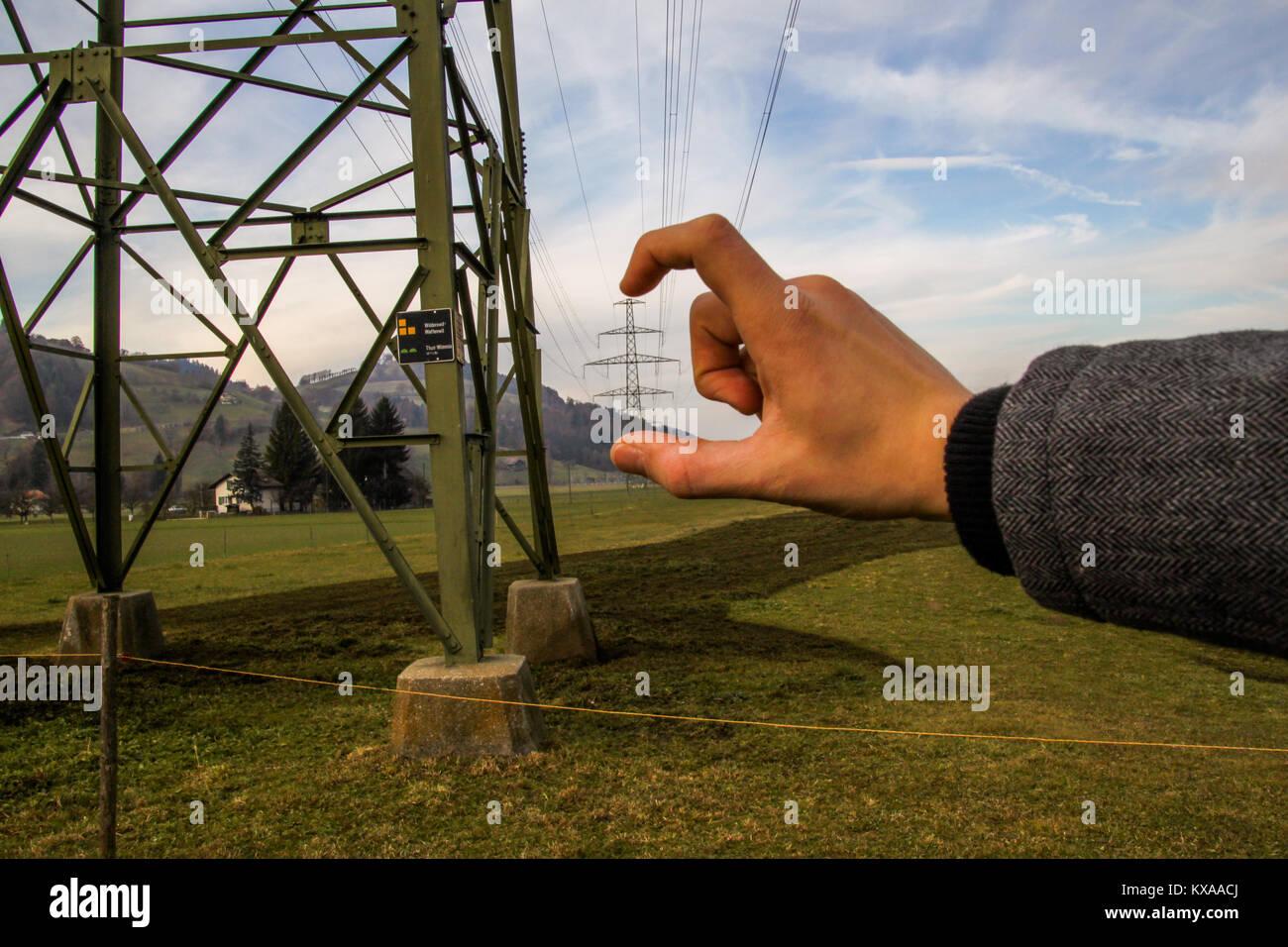 Man Holding Powerlines - Stock Image