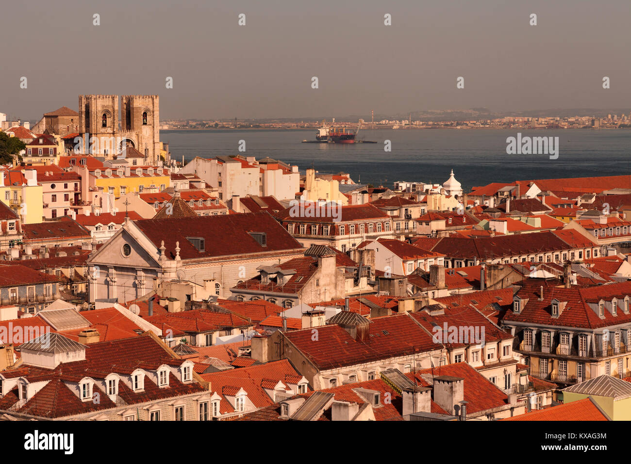 View over rooftops and cathedral Se Patriarcal,Alfama,Rio Tejo,Lisbon,Portugal - Stock Image