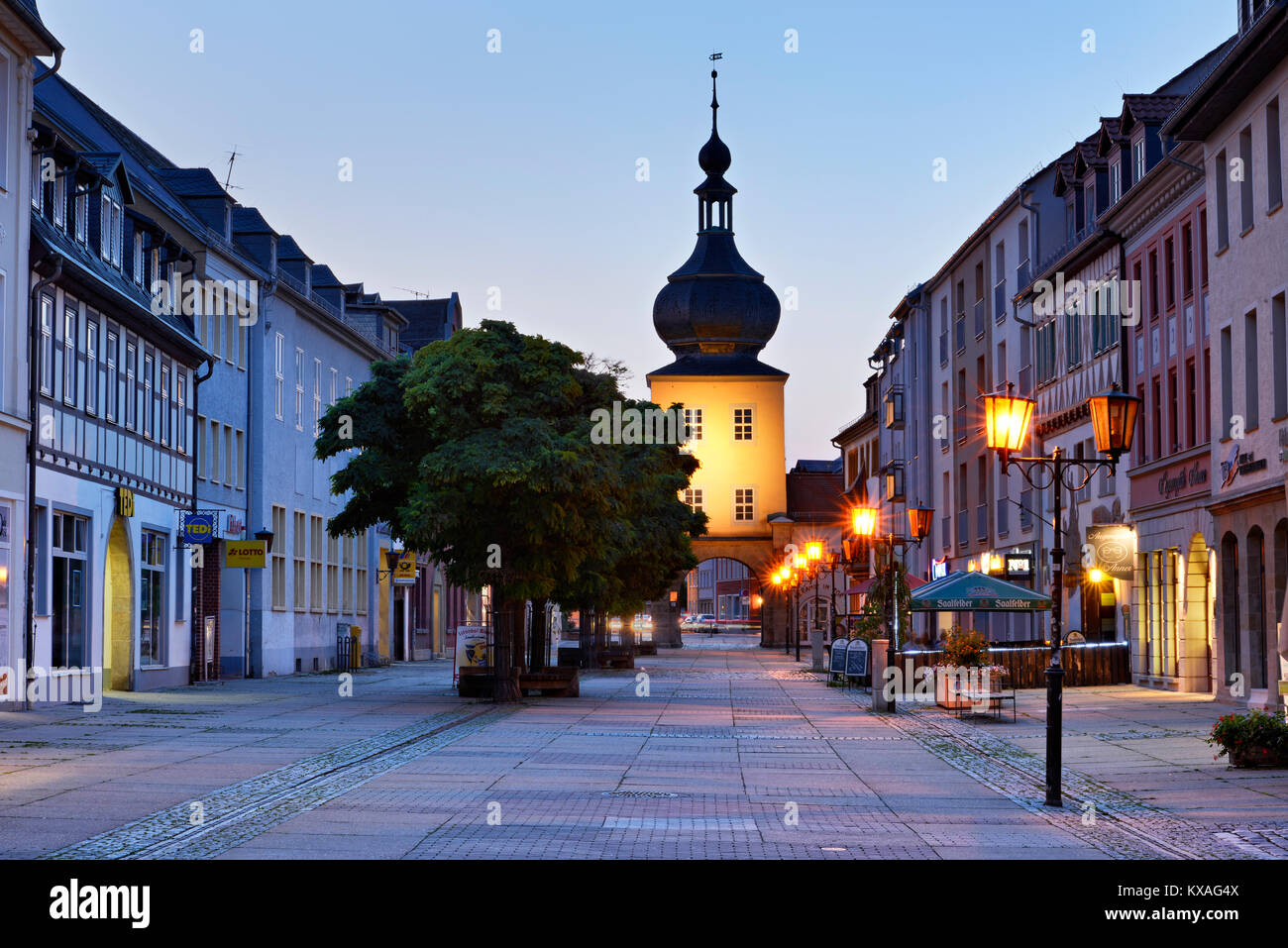 Blankenburger Tor and pedestrian precinct,dusk,Saalfeld,Thuringia,Germany - Stock Image