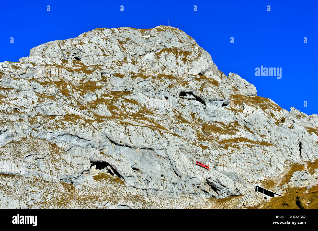 Red railcar of the Pilatus Railway on the steep railway line at Mount Pilatus,Alpnachstad,Switzerland - Stock Image