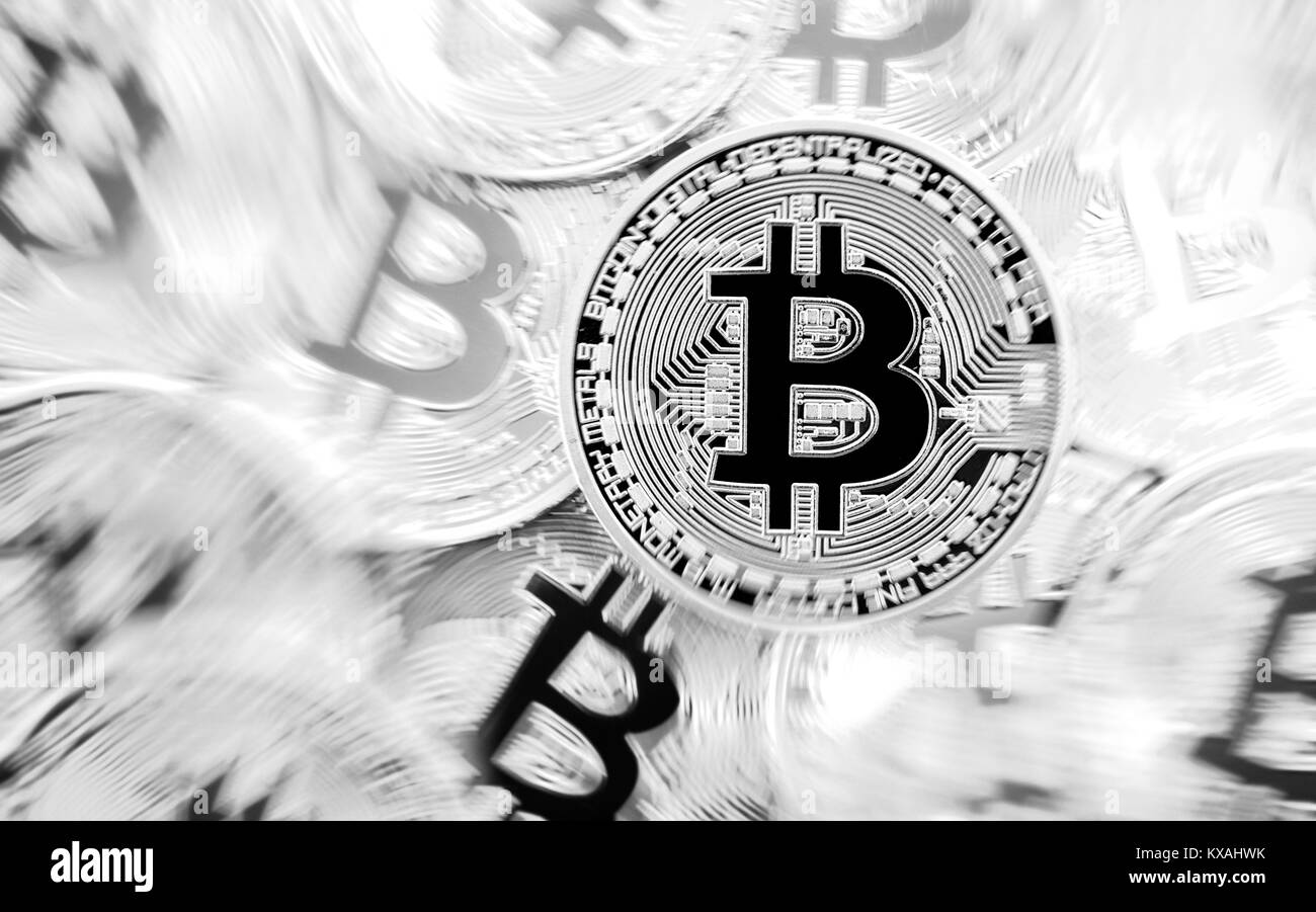 Symbol image turbulence stock market crash digital currency, black and white physical coin Bitcoin - Stock Image