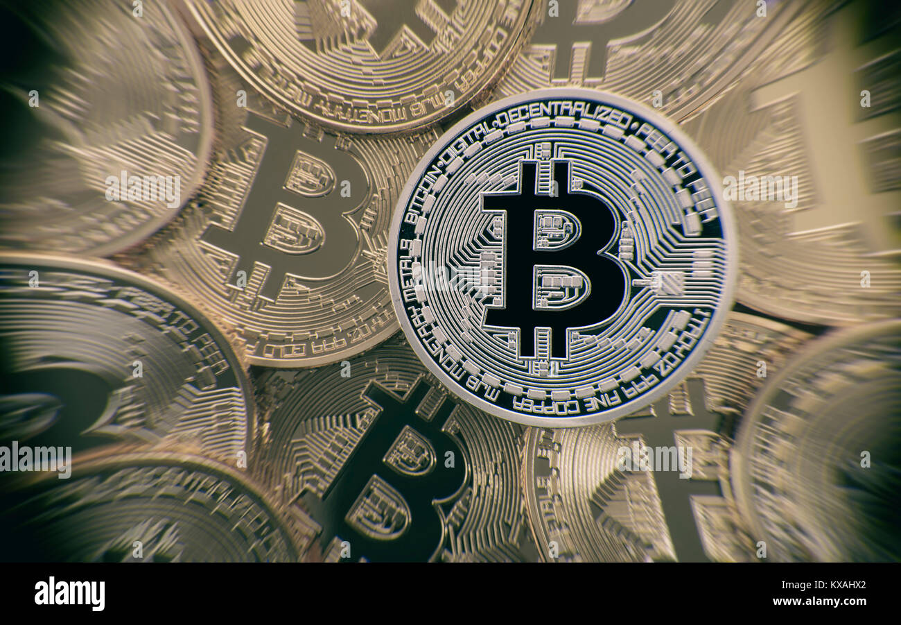 Symbol image turbulence stock market crash digital currency, silver among gold physical coins Bitcoin - Stock Image