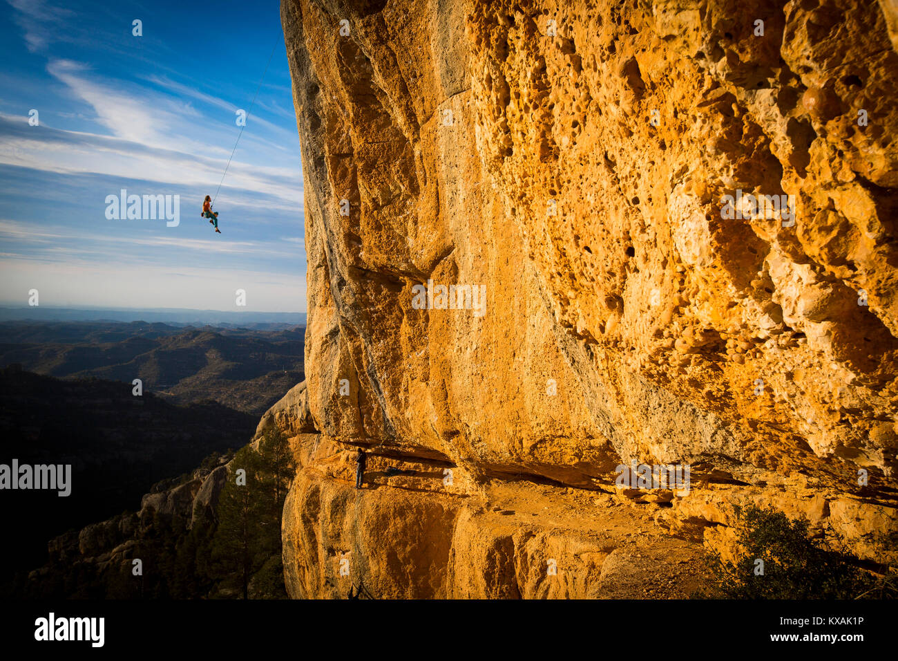 Climber swinging from climbing rope, Magaluf, Catalonia, Spain - Stock Image