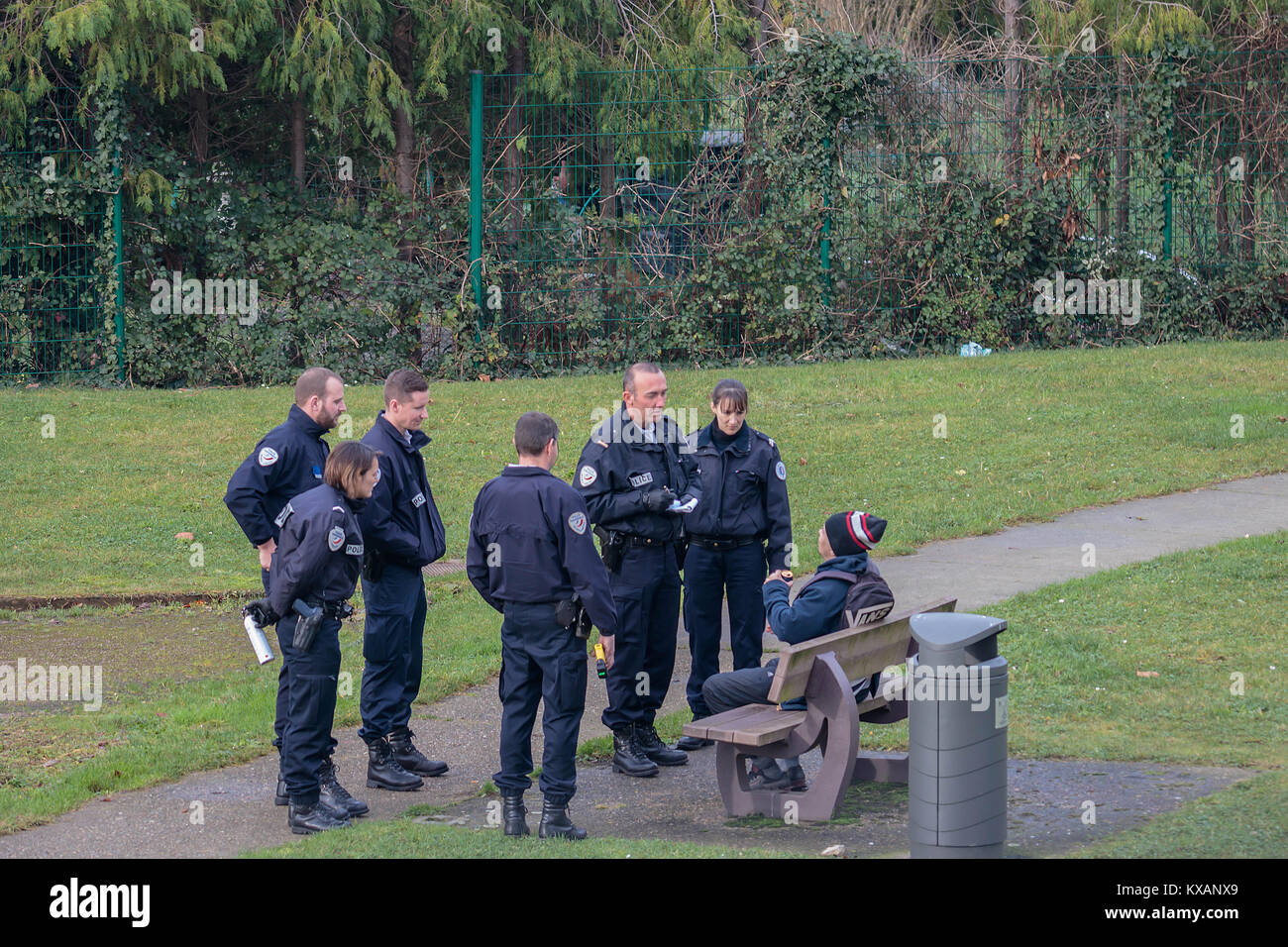 Armed French Police Speaking To A Drunken Man In Gonfreville L'Orcher, Normandie, France - Stock Image