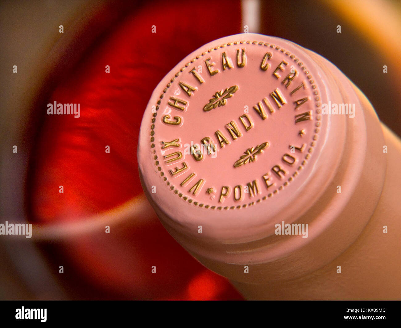 VIEUX CHATEAU CERTAN POMEROL close up embossed encapsulation wine bottle top name Fine Bordeaux Merlot red wine - Stock Image