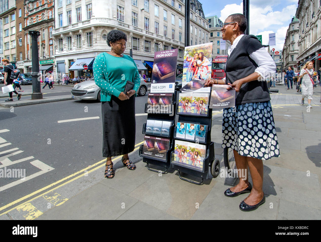 London, England, UK. Jehovah's Witnesses in Regent Street with copies of 'Awake!' - Stock Image