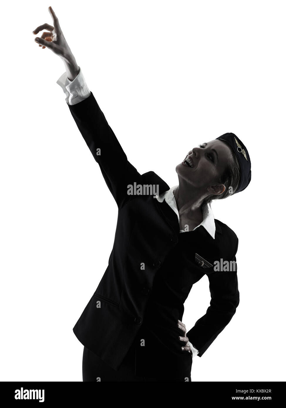 one caucasian Stewardess cabin crew  woman pointing showing isolated on white background in  silhouette - Stock Image