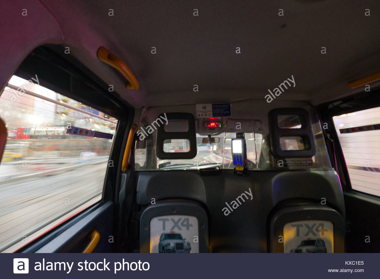 Inside passenger compartment of a hackney carriage at night, City of Westminster, London, England, United Kingdom - Stock Image