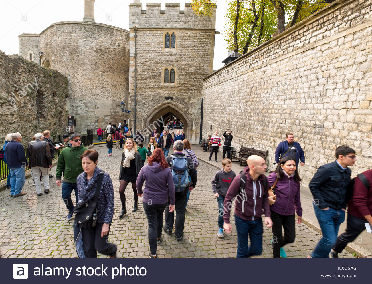 People walking through the Bloody Tower inside the Tower of