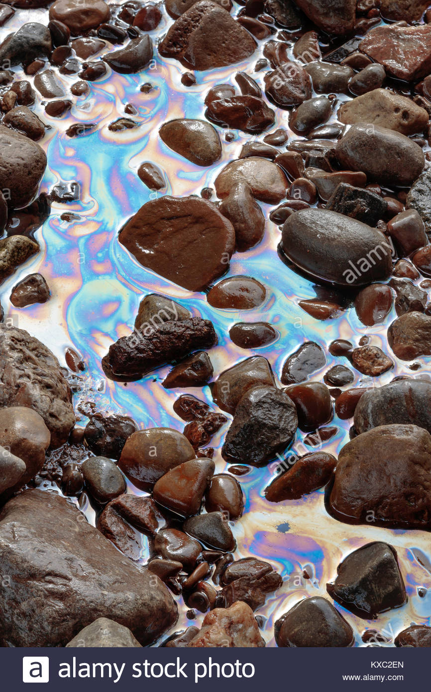 Water pollution oil entering river from storm sewer  petroleum chemical liquid fuel toxic ecology petrol leak polluted - Stock Image