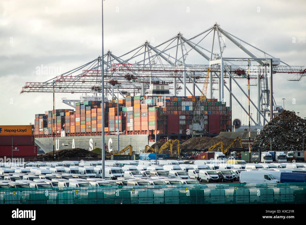 Container/ cargo ship being loaded/ unloaded in the Port of Southampton December 2017, England, UK Stock Photo