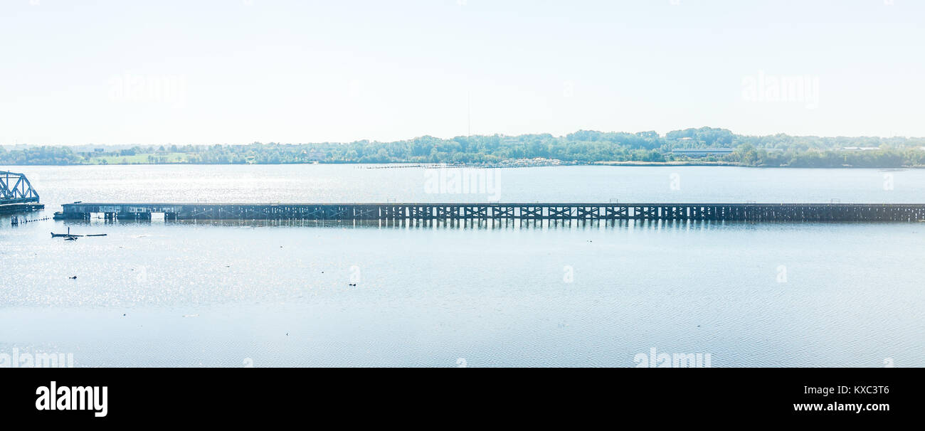 Middle Branch Patapsco river panorama with railroad swing bridge during day in Baltimore, Maryland, USA - Stock Image