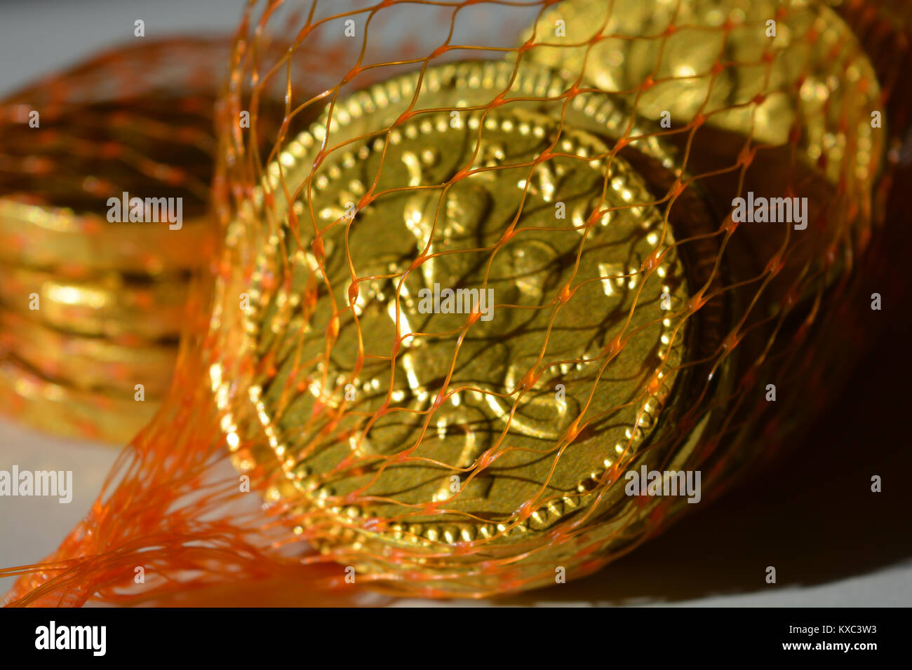 Chocolate money stock photos chocolate money stock images alamy chocolate coins in a net bag a traditional christmas gift stock image spiritdancerdesigns Image collections