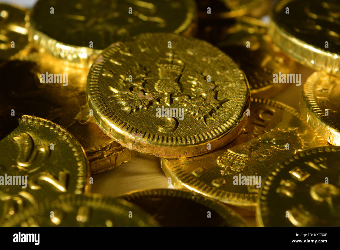 Chocolate money stock photos chocolate money stock images alamy chocolate coins wrapped in gold foil a traditional british christmas gift stock image spiritdancerdesigns Image collections