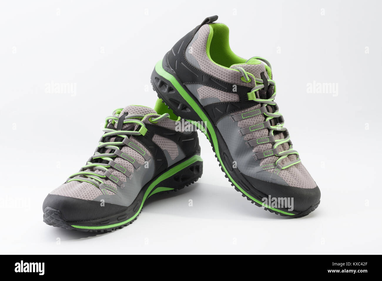 Outdoors shoes for man for different activities, trail running, free running, fast climbing, hiking, studio shoot - Stock Image