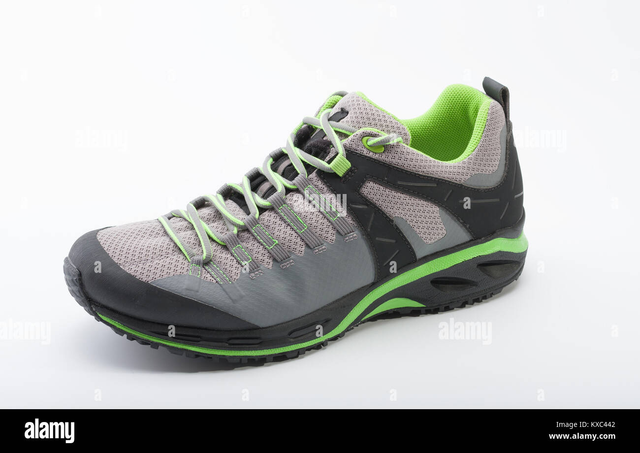 Outdoors shoe for man for different activities, trail running, free running, fast climbing, hiking, studio shoot - Stock Image