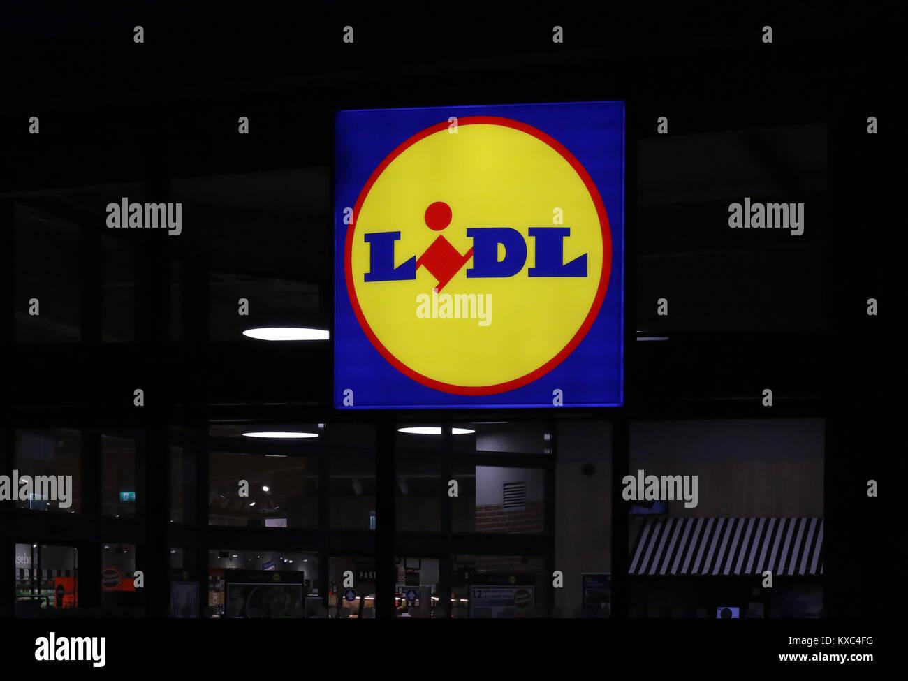 Illuminated Lidl sign at Lidl Supermarket - Stock Image