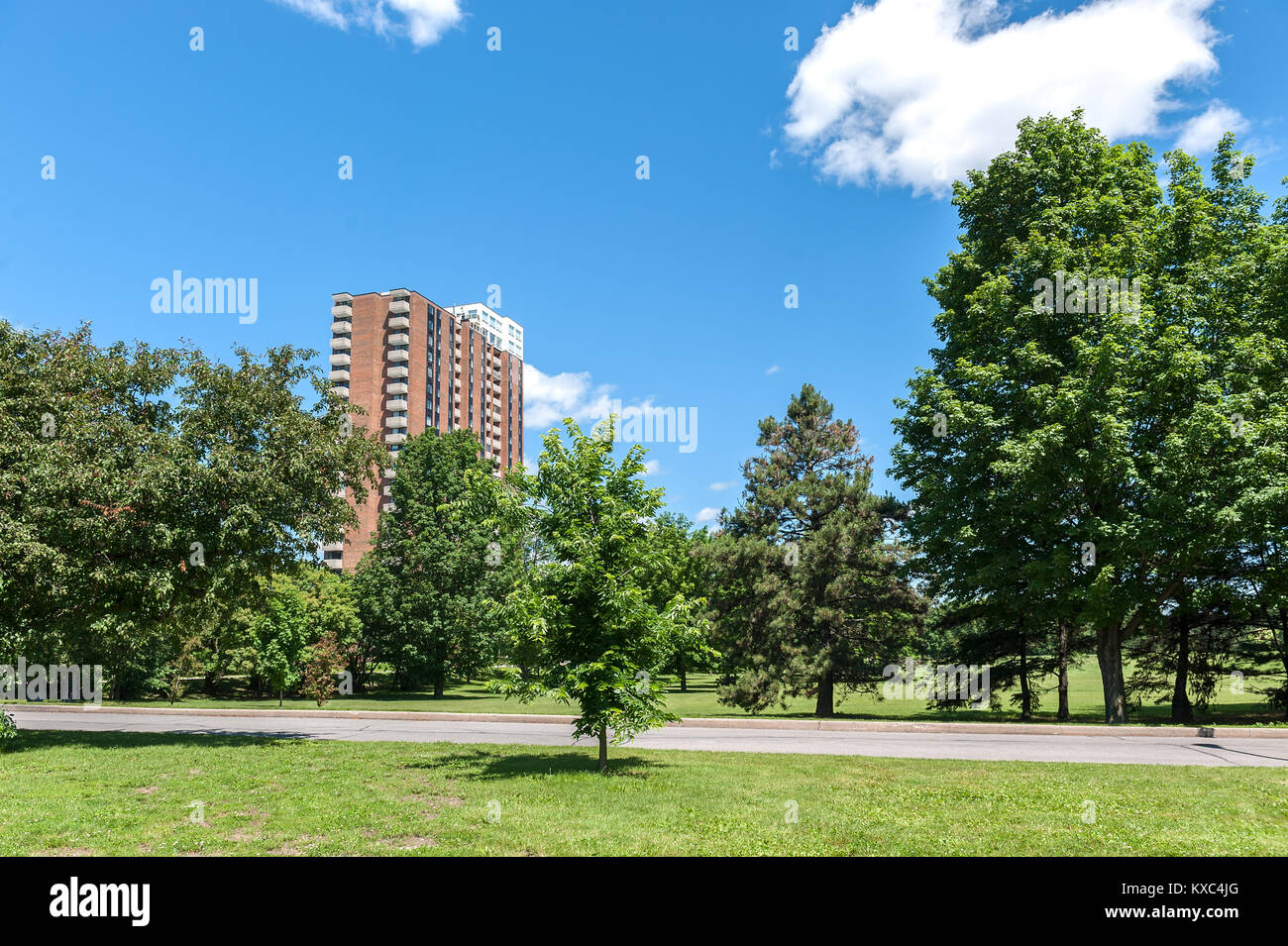 Apartment building and parkland view Stock Photo