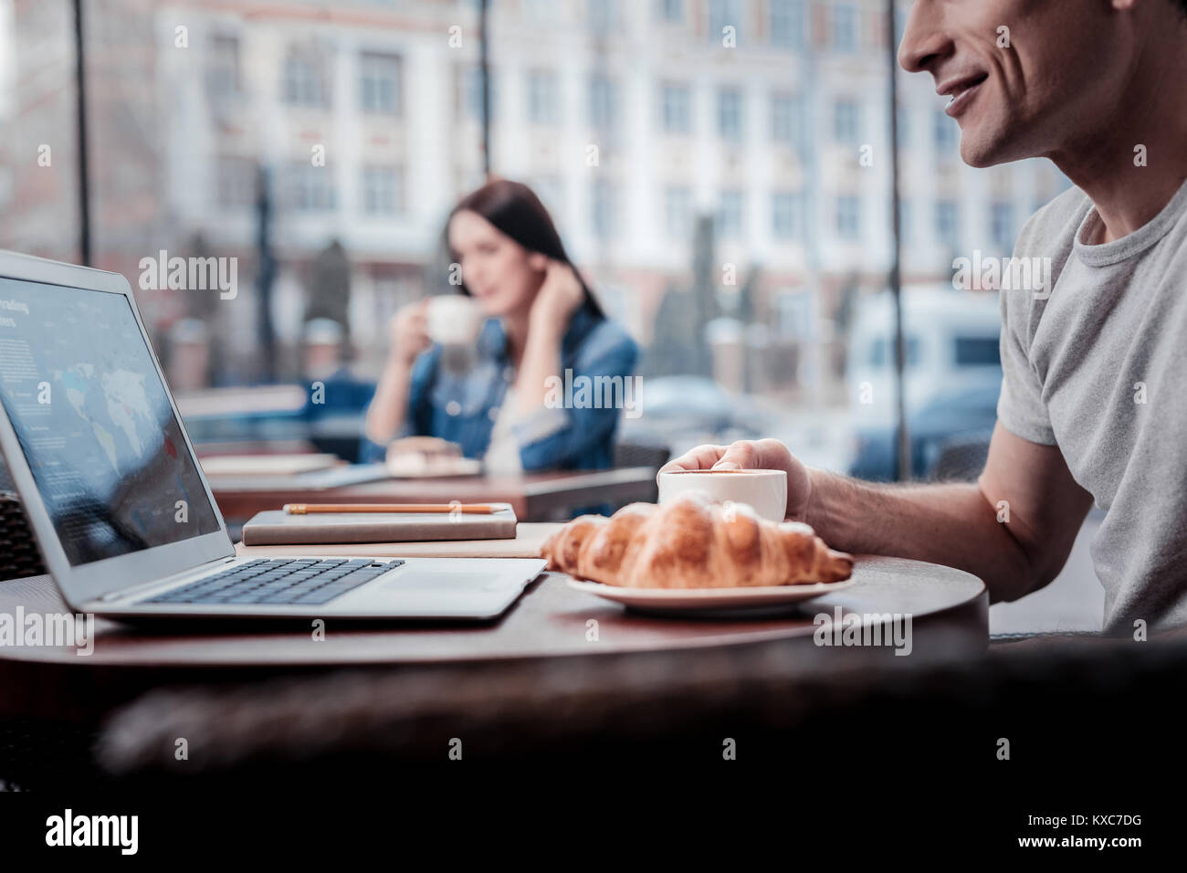 Close up of delighted man that having break - Stock Image