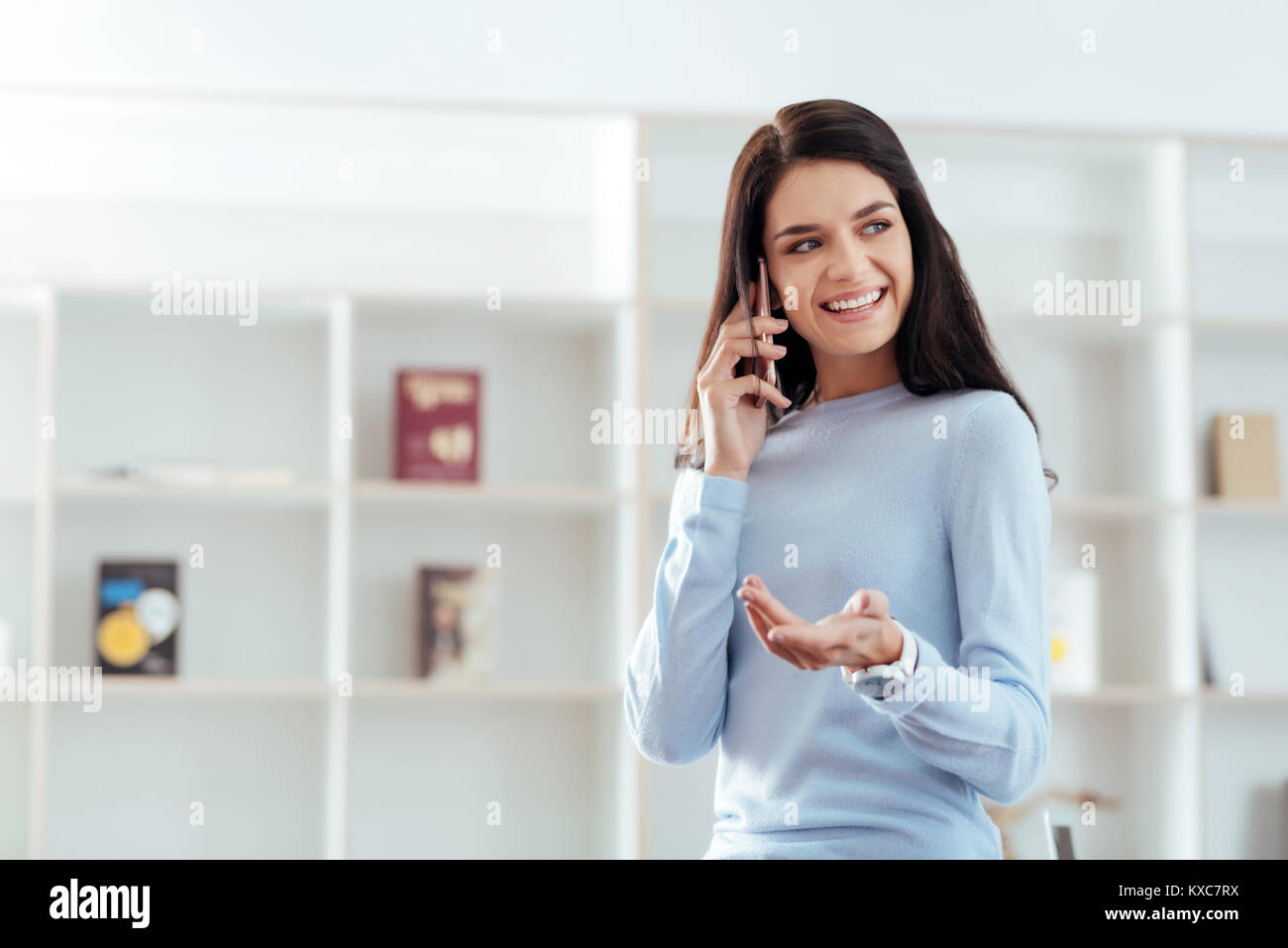 Nice energetic woman talking to friend  - Stock Image