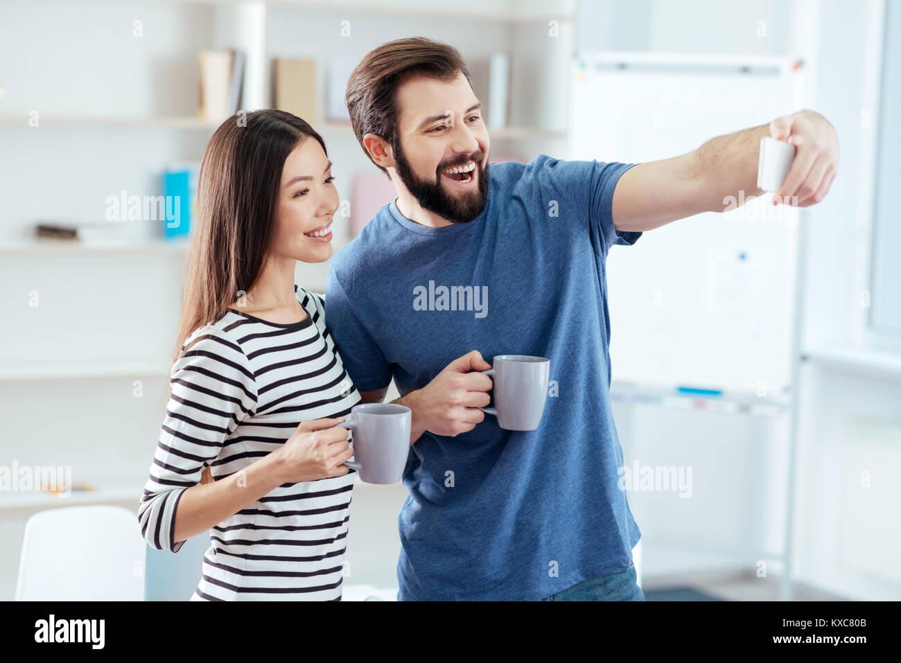 Vigorous pleased couple fixing moment - Stock Image