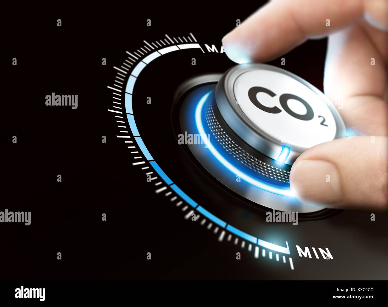 Man turning a carbon dioxyde knob to reduce emissions. CO2 reduction or removal concept. Composite image between - Stock Image