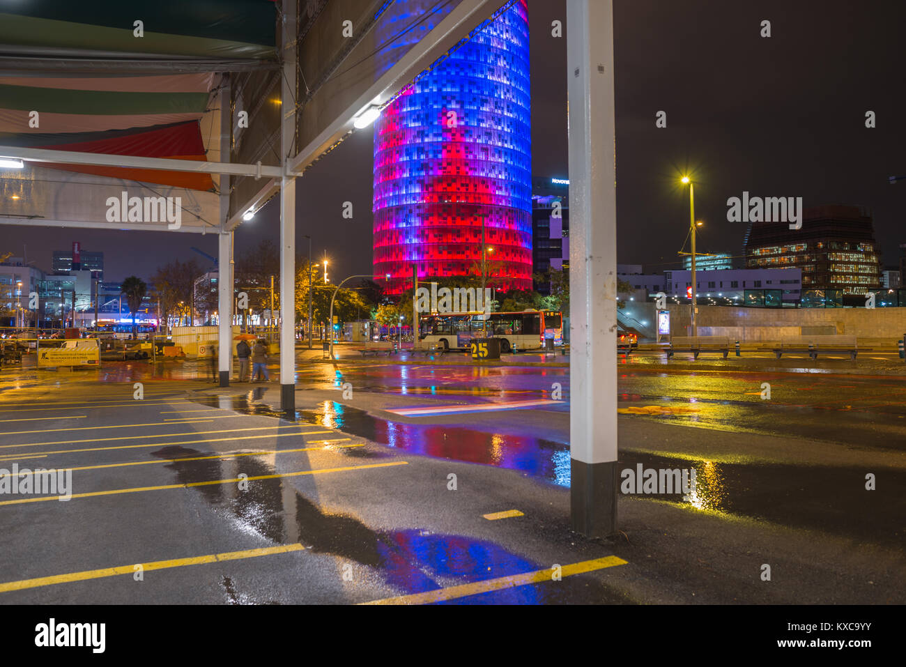 Agbar Tower, by Jean Nouvel reflected in paddles on a rainy night at Glories district bus shelter. Barcelona. Spain. Stock Photo