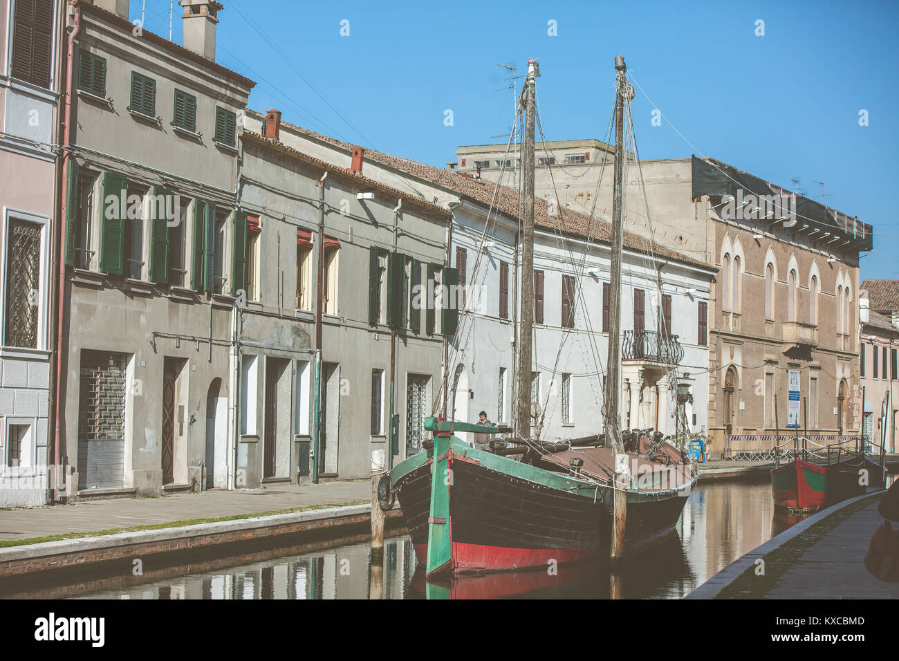 Comacchio, Italy. A boat in a channel of the italian city called 'the little Venice' - Stock Image