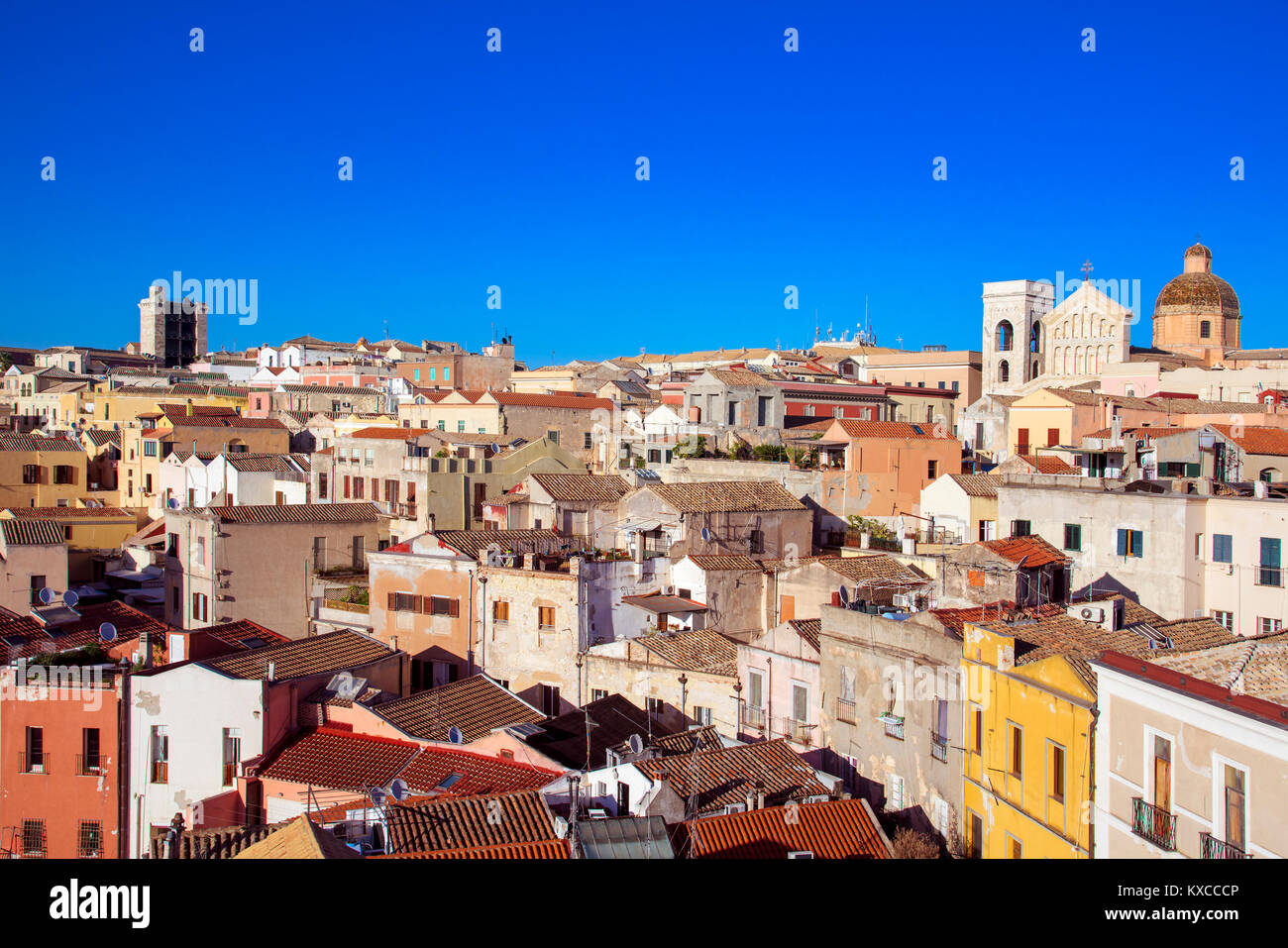 an aerial view of the old town of Cagliari, in Sardinia, Italy, highlighting the bell tower and the top of the facade - Stock Image