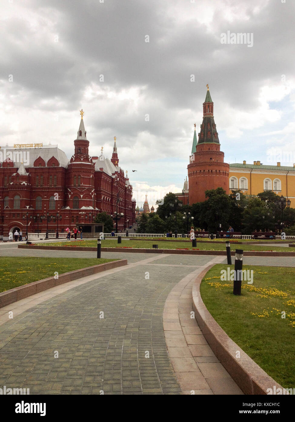 Outskirts view of part of the Red Square with two towers and Saint Basil's far off in the background, with stone - Stock Image