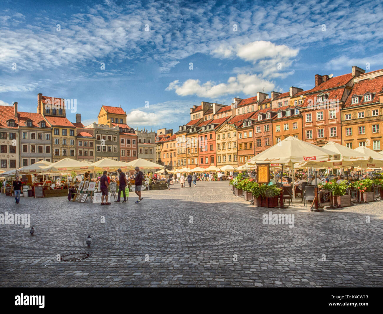 Warsaw, Poland - June 02, 2017: Cafes, stalls, colorful buildings  and the people at Old Town Square (Rynek Stare - Stock Image