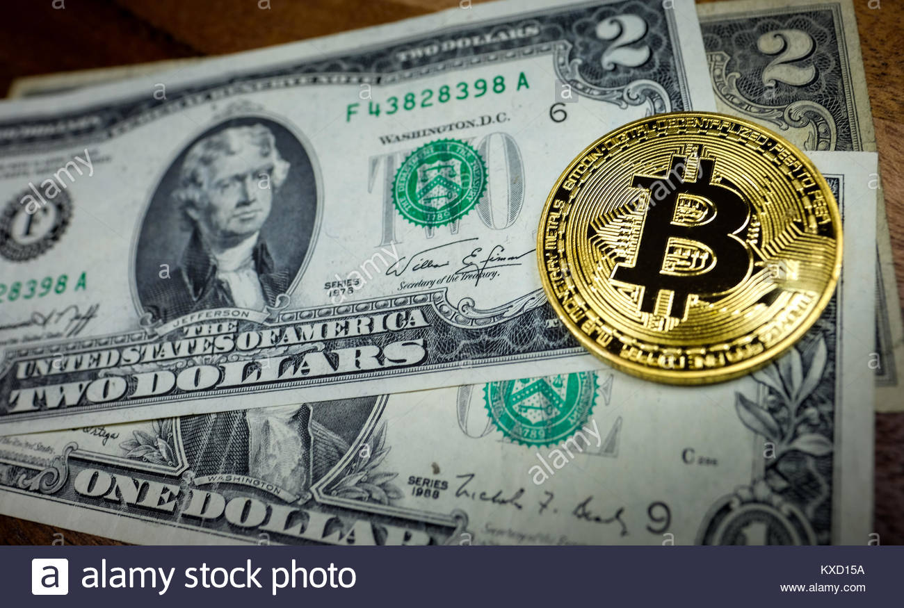 Bitcoin with US Dollar bank note - Stock Image