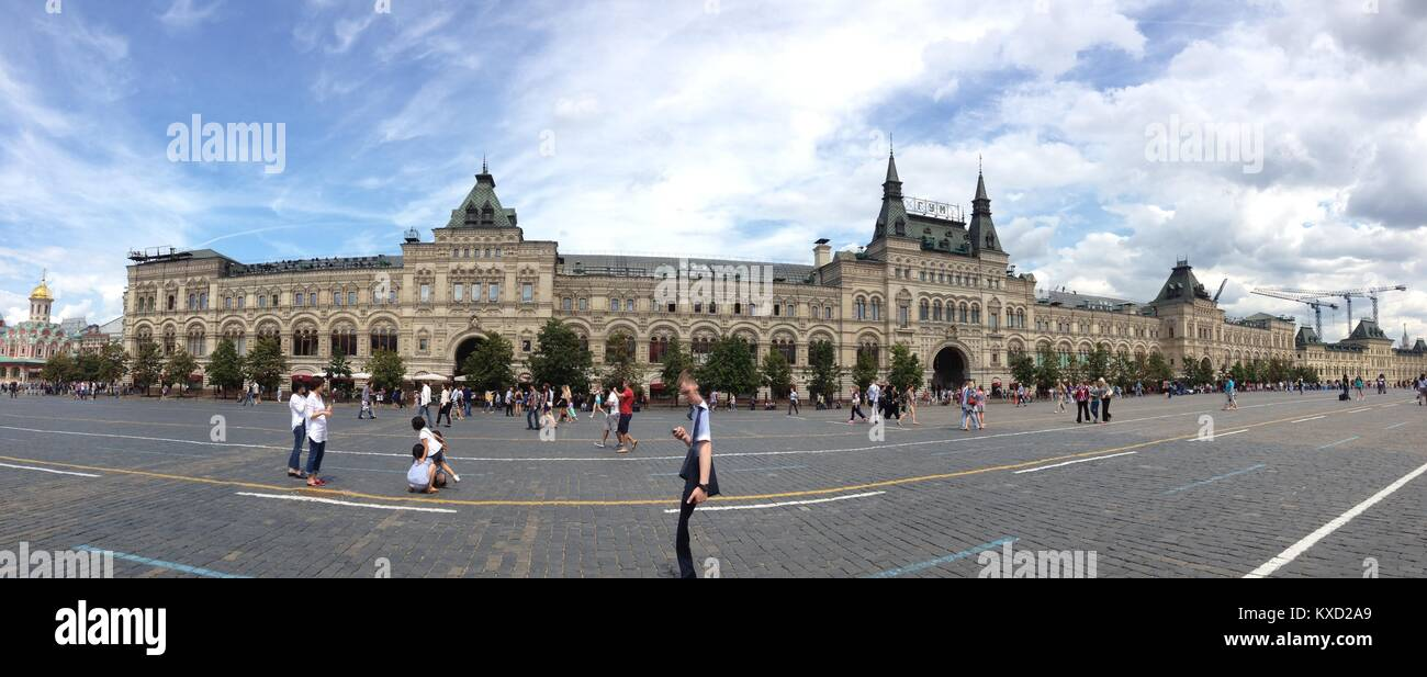 View of the GUM-Glavny Universalny Magazin Department Store across from the Red Square, with a big blue sky and - Stock Image