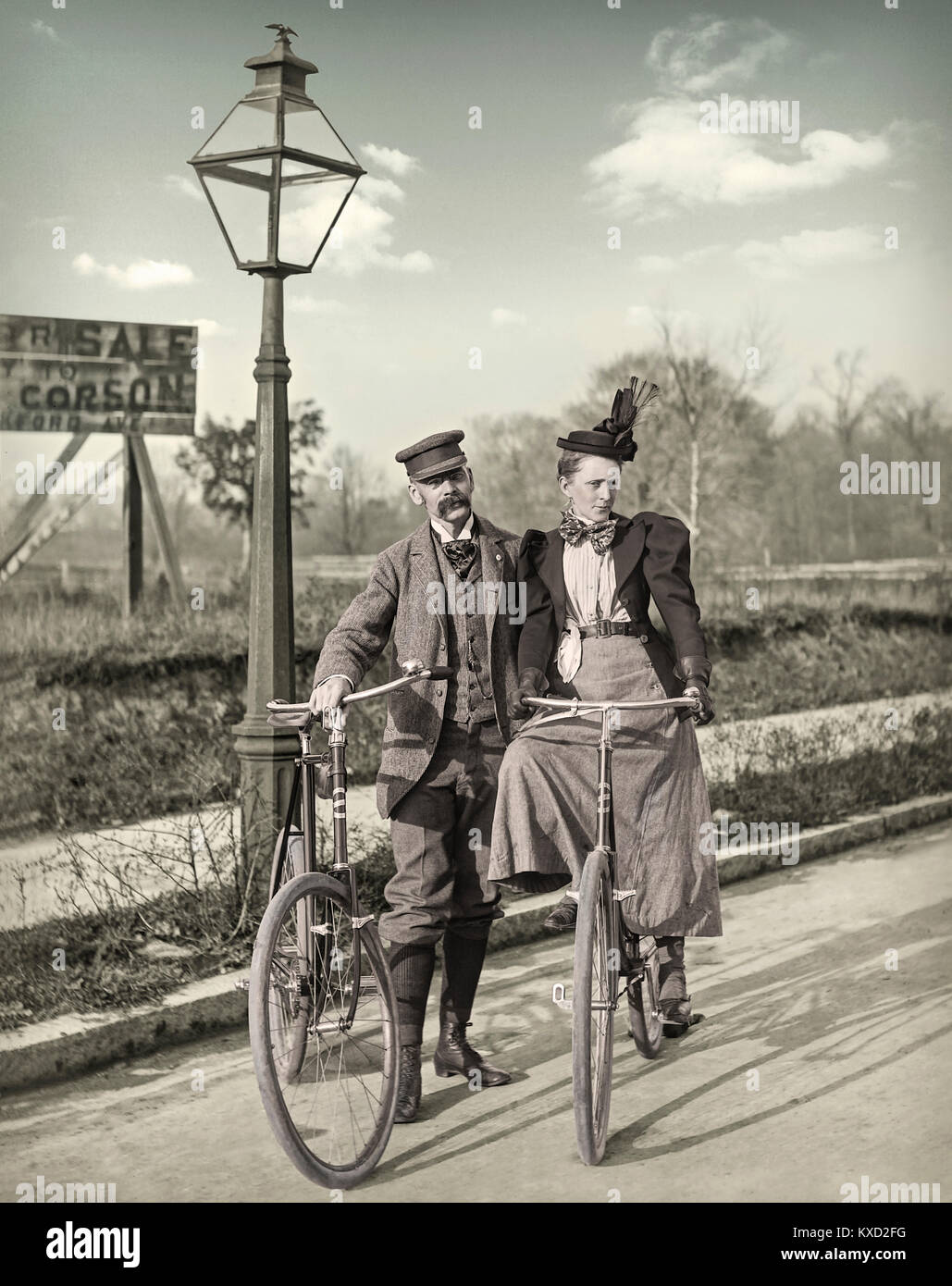 """1890 Man & Woman with Bicycles Philadelphia Pennsylvania. Background reads """"For Sale Apply to Corson Frankford - Stock Image"""