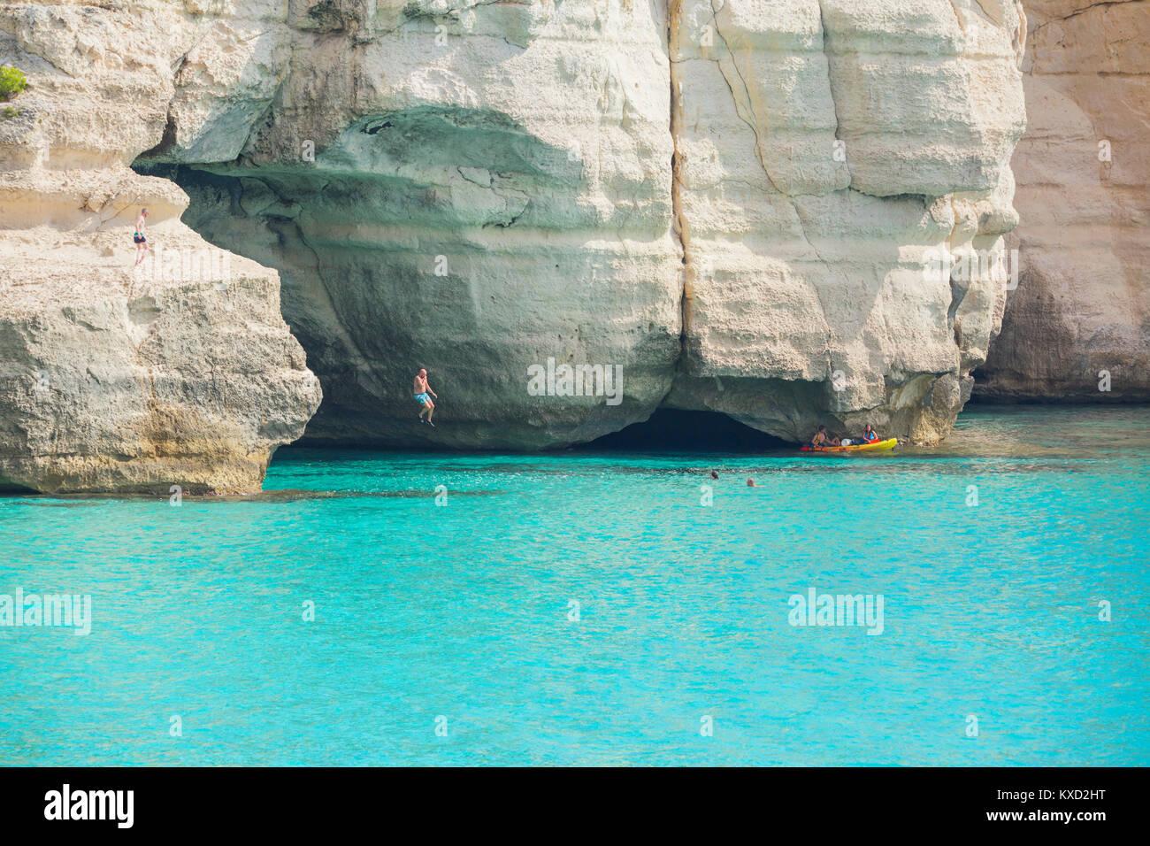 People canoeing and jumping into the water near Cala Mitjana, Menorca, Balearic Islands, Spain Stock Photo