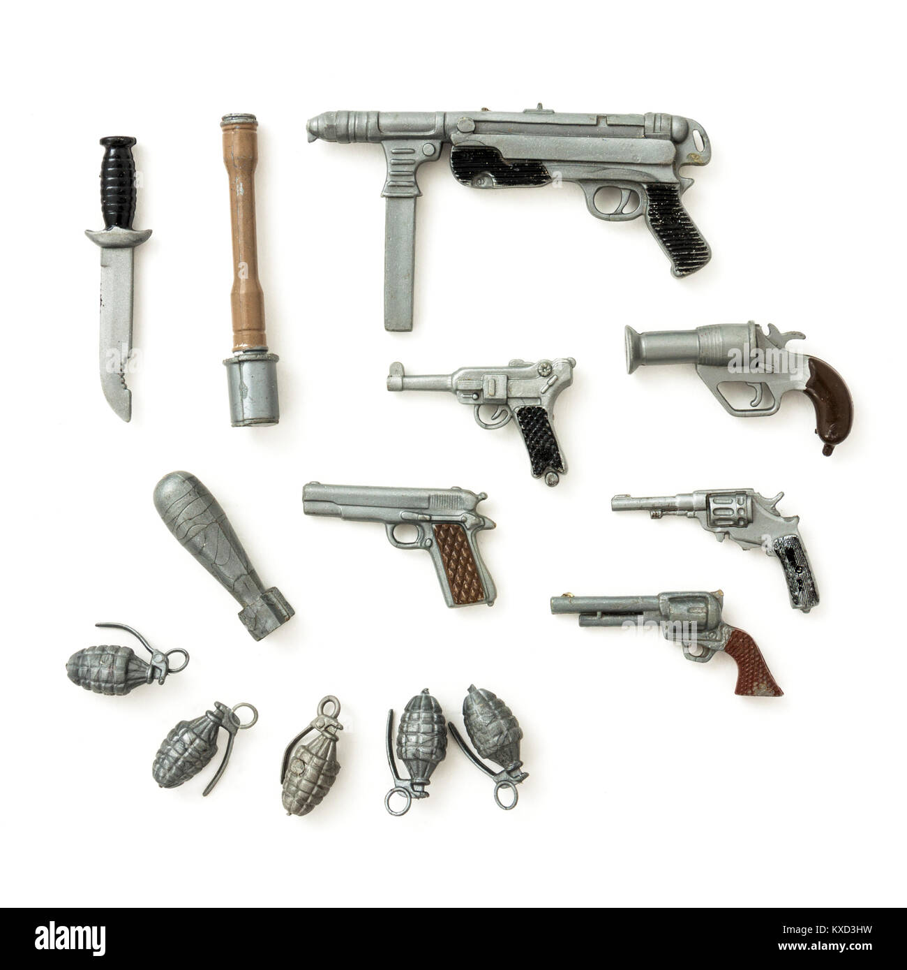 Selection of vintage Action Man weapon accessories from the 1960s made by Palitoy in England, including several - Stock Image