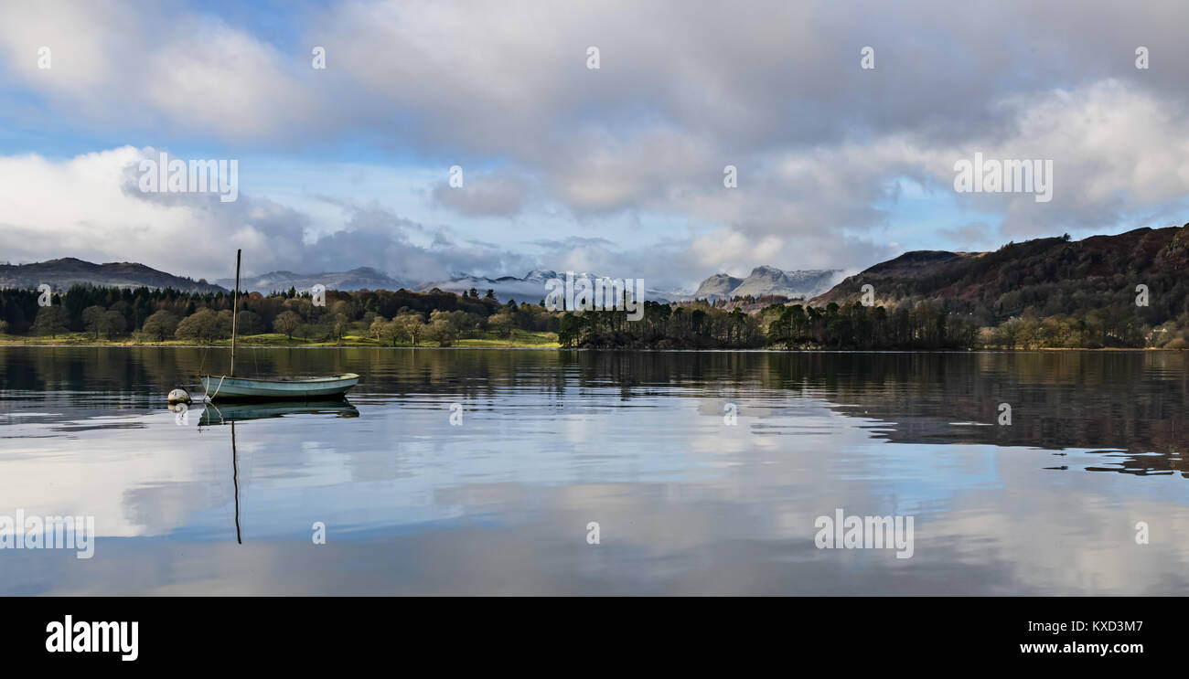 Panoramic view across Windermere from Waterhead, Ambleside with the Langdales and snow covered Crinkle Crags in - Stock Image